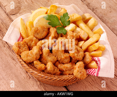BASKET OF SCAMPI AND CHIPS - Stock Photo