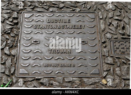Iron manhole cover made by Ductile Stanton and Staveley The Trojan - Stock Photo