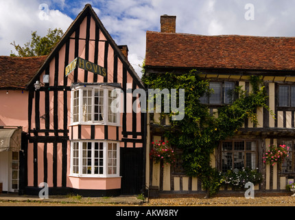 Half timbered traditional buildings in historic Lavenham Village Suffolk England UK with typical vernacular architecture - Stock Photo