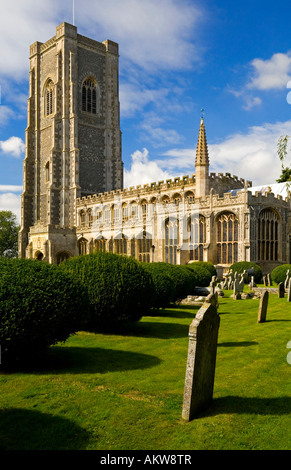 The Church of Saints Peter and St Paul in Lavenham village Suffolk Eastern England UK with gravestones in the foreground - Stock Photo