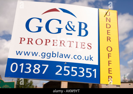 Property real estate under offer estate agents sign advertising property for sale UK - Stock Photo