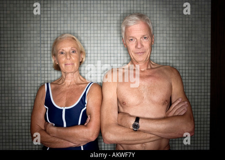 Senior couple in changing room - Stock Photo