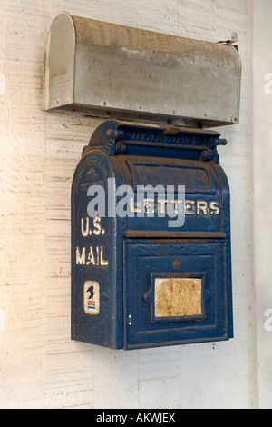 Rural U S mailboxes hanging on wall. - Stock Photo