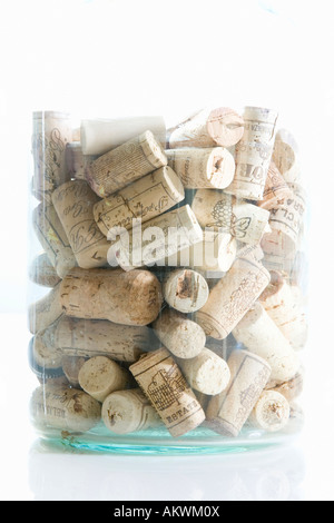 Glass flask containing corks, clpse-up - Stock Photo