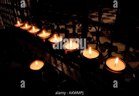 Austria, Karlskirche, Large group of candlelights burning, close-up - Stock Photo