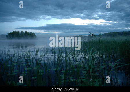 A landscape of a big misty lake in Kuopio Finland - Stock Photo