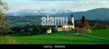 Pilgrimage church Wilparting near Irschenberg in front of bavarian mountains, Upper Bavaria - Stock Photo