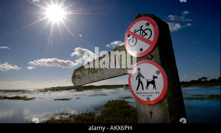 A public footpath sign against dramatic blue sky in Sidlesham West Sussex. Picture by Jim Holden. - Stock Photo