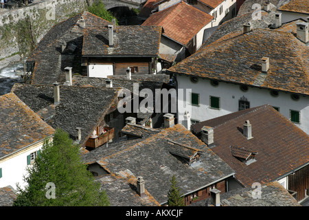 View over the roofs of old Splügen, distinguished with the Wakker price of the Swiss homeland protection organization - Stock Photo