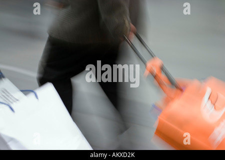 Businessman with suitcase - Stock Photo