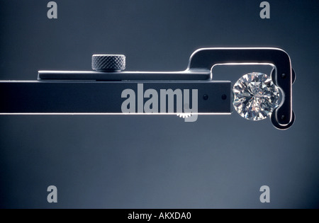 A cut and diamond held in an inspection tool - Stock Photo