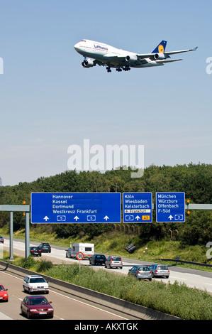 Lufthansa, Boing 747 above the highway to the Frankfurt Airport, Frankfurt am Main, Hesse, Germany - Stock Photo