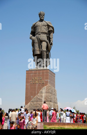 Many people below the monument of Amir Timur Shahrisabz Uzbekistan - Stock Photo