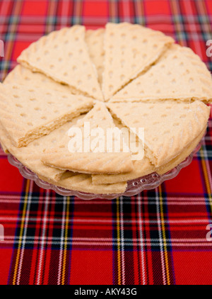 Traditional scottish shortbread shot on Tartan fabric - Stock Photo