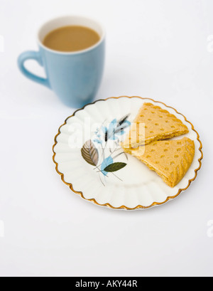 China mug of tea with shortbread biscuits - Stock Photo