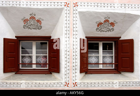 Windows of an Engadin house decorated with Sgraffito ornaments, Scuol, Schuls, Lower Engadin, Grisons, Switzerland - Stock Photo