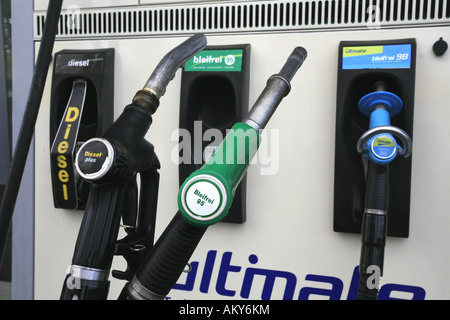 Fuel nozzles at a gas station with Diesel and Unleaded Fuel - Stock Photo