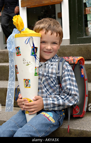 Schoolboy with schoolcone at his first day at school - Stock Photo