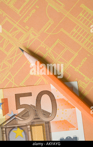 Pencil and money on a diagram - Stock Photo