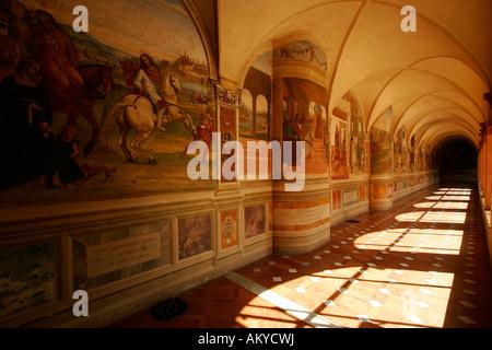 Cross-coat, cloister Abbazia di Monte, Oliveto Maggiore, Buonconvento, Tuscany, Italy - Stock Photo