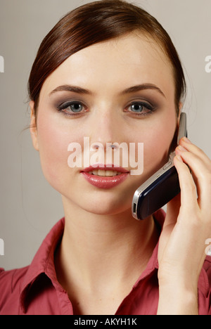 Young woman at the cell phone Stock Photo