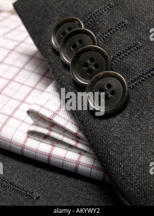 So called kissing buttons like on the sleeve of this Hugo Boss suit are a sign of high quality - Stock Photo