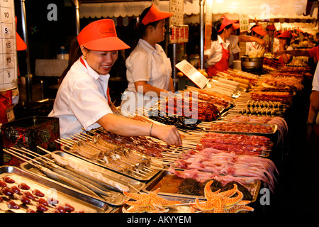 Night market in Donghuamen street after dark, Beijing, China - Stock Photo