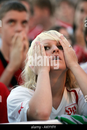 Shocked Supporters of the German soccer team VfB Stuttgart after their team has lost the German Cup final Stuttgart - Stock Photo