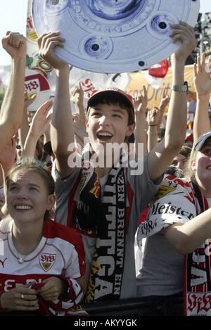 Supporters of the German soccer team VfB Stuttgart celebrating the German Cup final Stuttgart Germany Baden-Wuerttemberg - Stock Photo