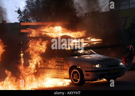 Monstertruck and Stuntshow, a car with a stuntman on the roof is driving through a wall of flames, Radeberg, Saxony, - Stock Photo