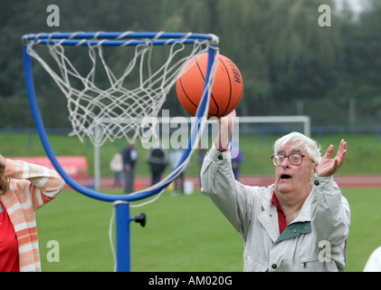 Handicapped man playing basketball - Stock Photo