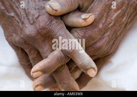 The hands of a laborer: an elderly Rajasthani man's hands clasped together in the village of Nimaj, Rajasthan, India. - Stock Photo