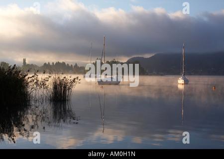 Boats on Woerthersee lake, Poertschach, Carinthia, Austria - Stock Photo