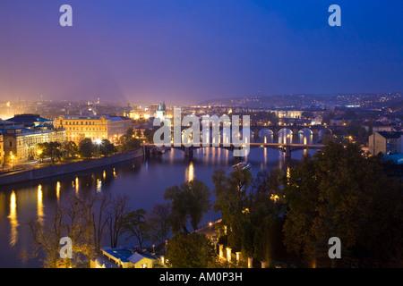 Look over Prague and Vltava at night Prague Czechia - Stock Photo