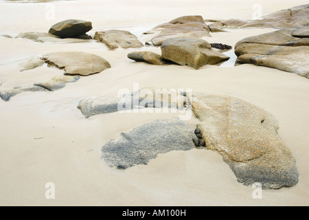 Granite rocks in tidal zone of sandy beach at the Altanic coast of Donegal, Ireland - Stock Photo