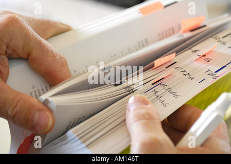 Book of laws with marker. Workers' council training. - Stock Photo