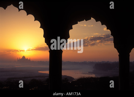 Sunrise over the Taj Mahal from Agra Fort Agra India - Stock Photo