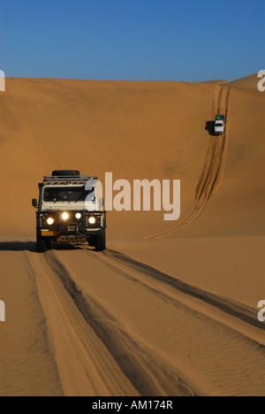 Jeeps on dunes near Sandwich Harbour, Diamond Area, Namibia - Stock Photo