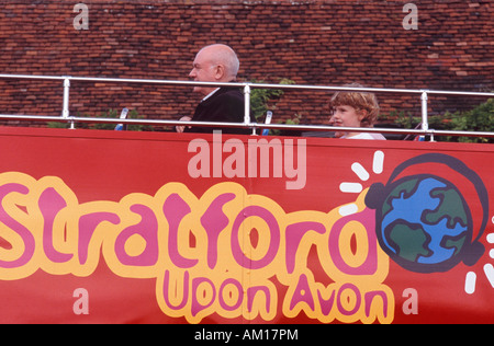 Tourists in Stratford: Man and happy little boy on top of doubledecker tour bus, Stratford Upon Avon Warwickshire - Stock Photo