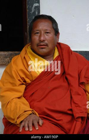 Monk with traditional robe, Paro, Bhutan - Stock Photo