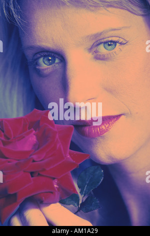 Woman with red rose and lips and blue eyes - Stock Photo