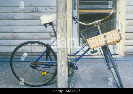 Bicycle parked on front porch Key West FL - Stock Photo