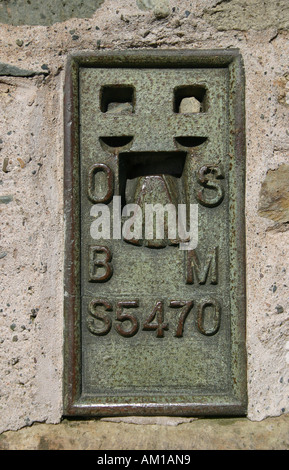 Plaque on triangulation pillar (trig point) on the summit of Loughrigg in the English Lake District. - Stock Photo