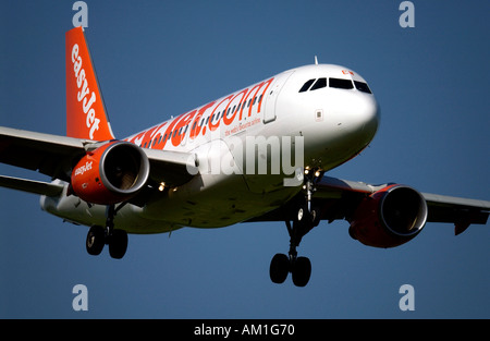 At London Gatwick Airport an EasyJet plane comes in to land - Stock Photo