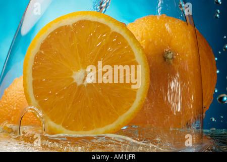 Oranges under water - Stock Photo