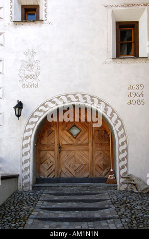Entrance of an Engadin house decorated with Sgraffito ornaments from the 17th centuary, Samedan, Engadin, Grisons, - Stock Photo