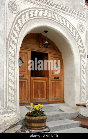 Entrance of an Engadin house decorated with Sgraffito ornaments, Scuol, Schuls, Lower Engadin, Grisons, Switzerland - Stock Photo