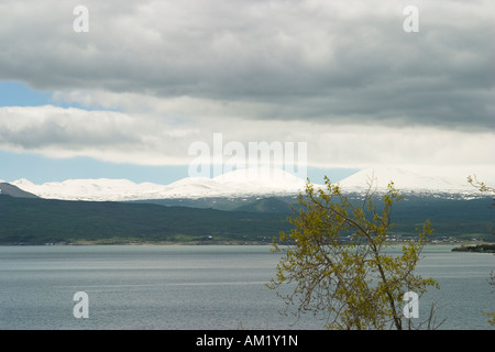 ARMENIA Lake Sevan Large freshwater lake snow capped mountains in distance - Stock Photo