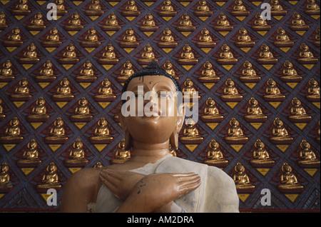 MALAYSIA Penang Island Georgetown Wat Buppharam or Wat Chayamangkalaram Temple Standing Buddha Statue with hands - Stock Photo