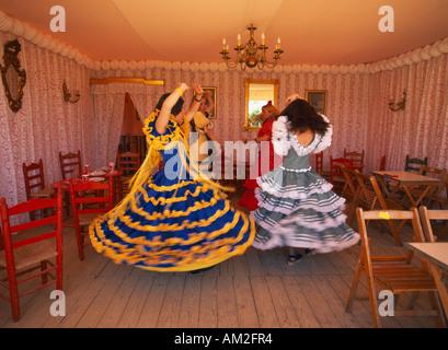 SPAIN Andalusia Seville April Fair or Feria de abril de Sevilla Four young girls Flamenco dancing in room of caseta marquee tent
